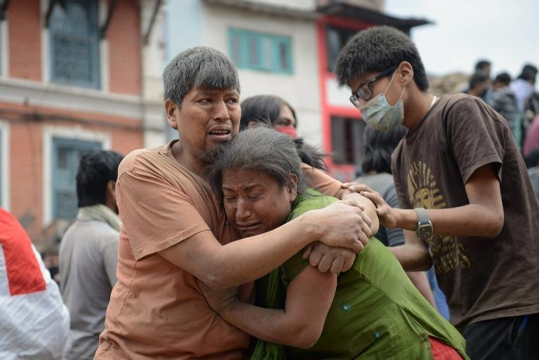 A Nepalese man and woman hold each other in Kathmandu's Durbar Square.