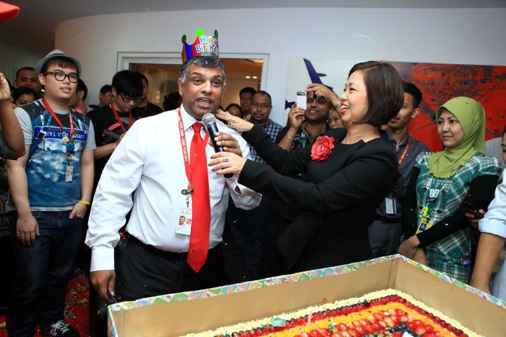 The AirAsia team surprising Tony Fernandes with a birthday party in 2012.