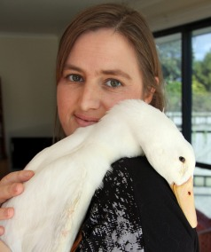 Adele Gichard cuddles Abner the duck.