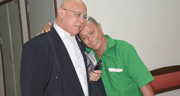 Augustine (left) with Bunya (right) smiling after the the court's discharge, justifies the Court of Appeal's ruling that the conviction was not safe based on three factors.