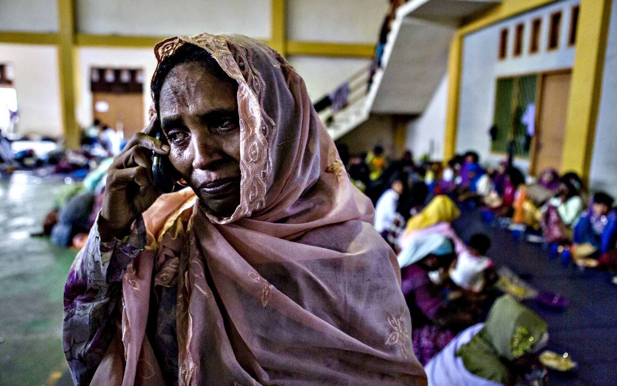 A Rohingya woman, Samsidah Begom binti Abdul Syukur, cries as she makes a phone call