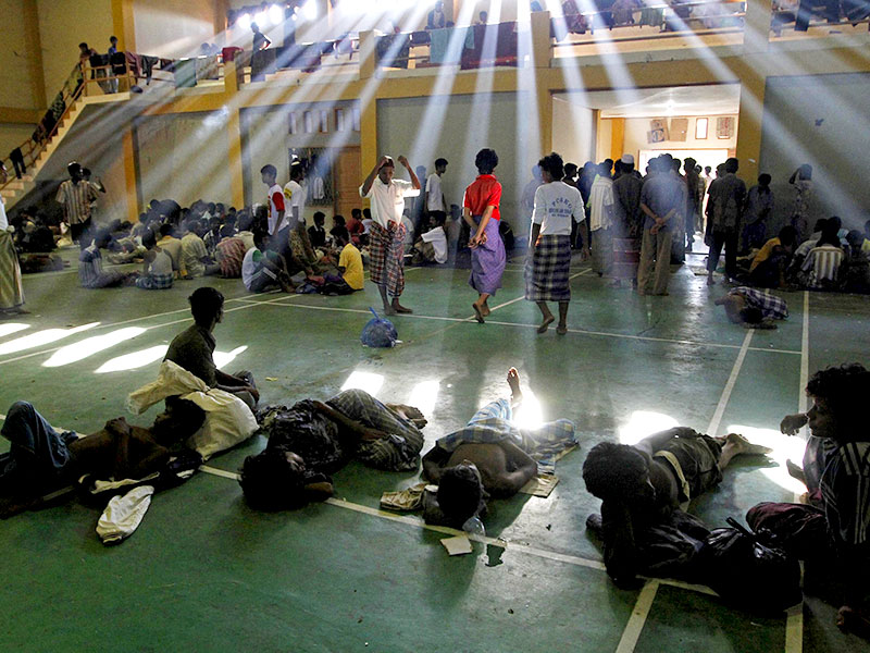 Migrants believed to be Rohingya inside a shelter after being rescued from boats, in Lhoksukon, Indonesia's Aceh Province.