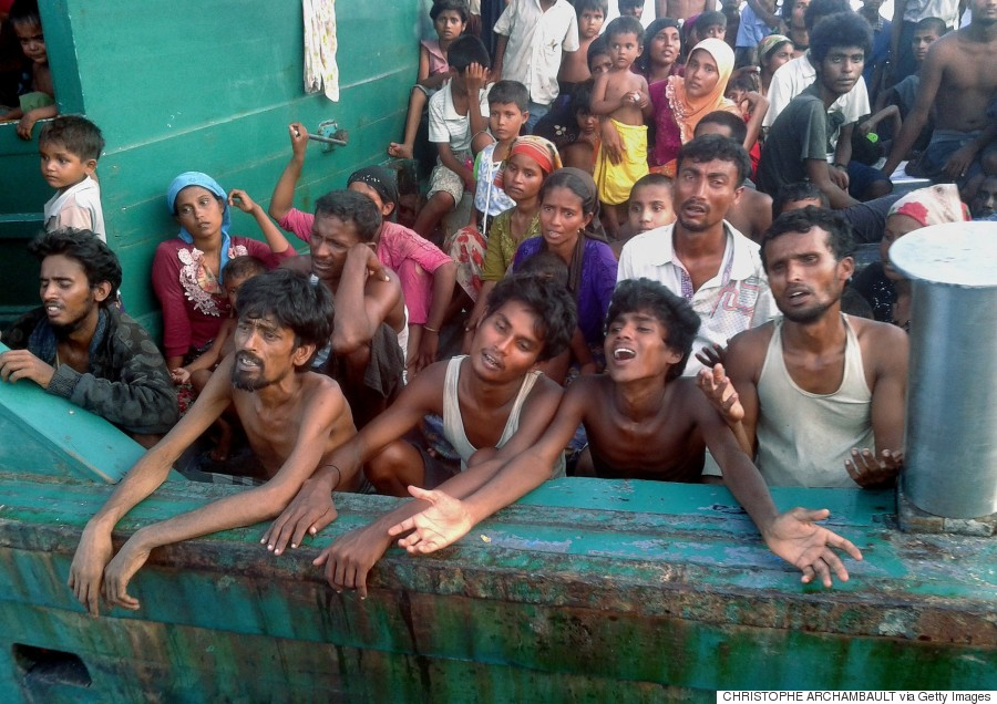 Rohingya refugees are pictured on a boat off the southern Thai island of Koh Lipe in the Andaman Sea on 14 May 2015.
