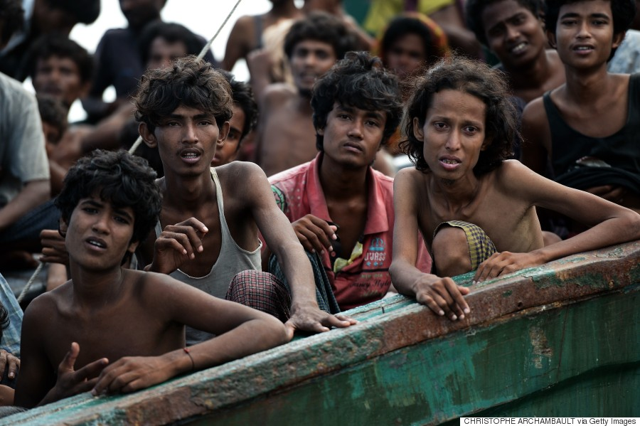 Rohingya migrants sit on a boat drifting in Thai waters off the southern island of Koh Lipe, 14 May 2015.