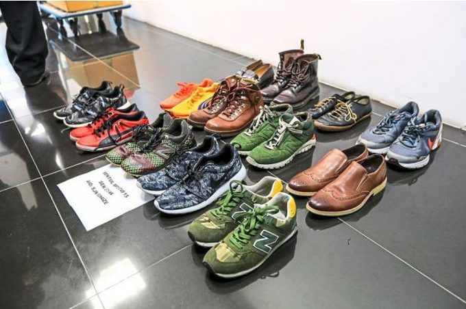 The shoes of varying sizes found by police were lined up in the Sentul police station.