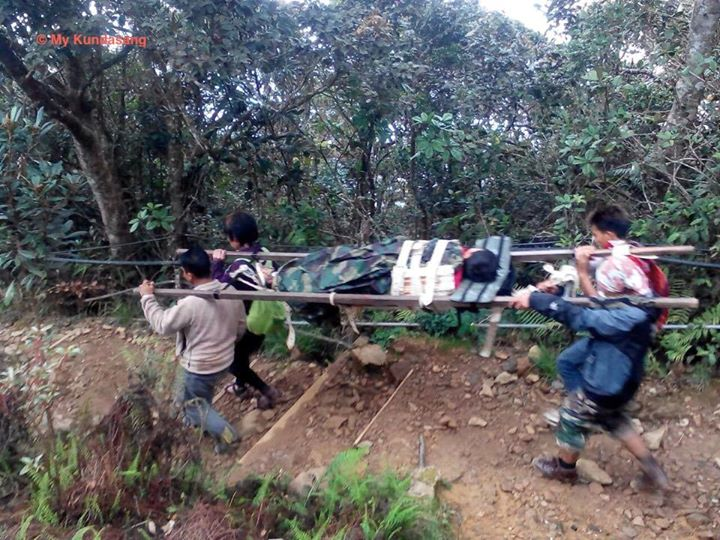 Mountain guides carrying an injured climber to safety after the quake trapped over 200 climbers there.