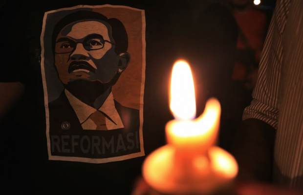 A file photo of Anwar Ibrahim's supporters holding a candlelight vigil outside the Sungai Buloh Prison in Kuala Lumpur on 11 February 2015.