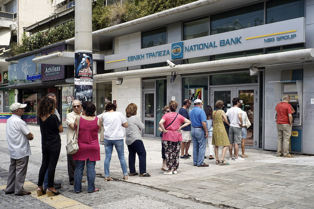 Long lines were seen at many ATMs on Sunday as Greeks scrambled to withdraw whatever funds they could from their bank accounts before they closed.