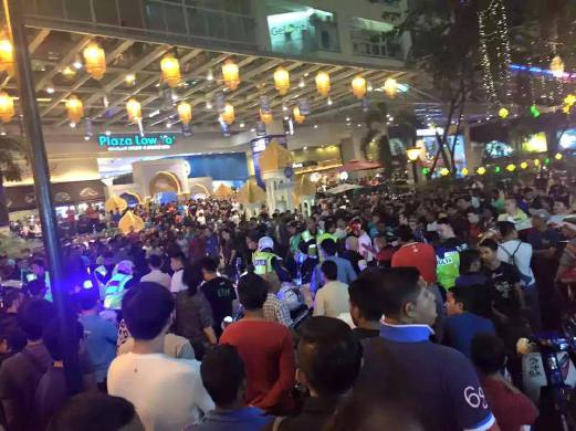 Large crowd gathered outside the Plaza during the incident.