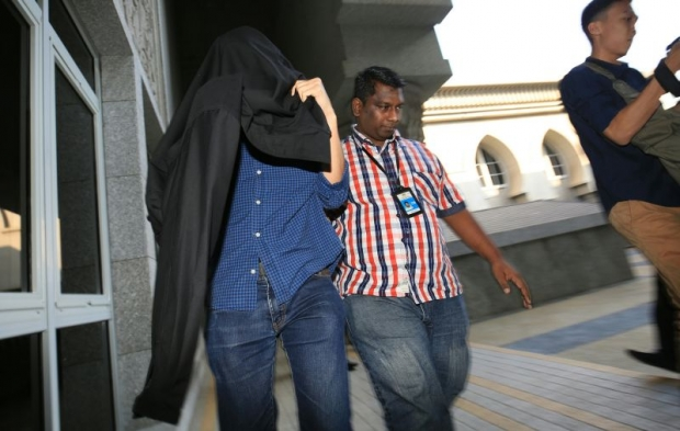 The director of a construction firm (left) who was arrested to aid in the 1MDB probe was released on bail today.
