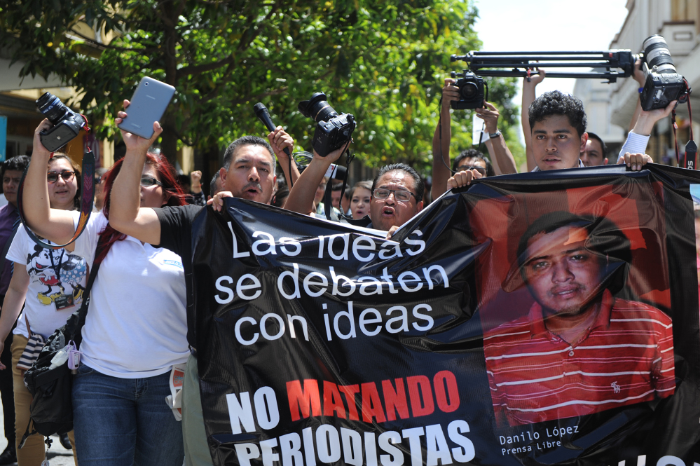Guatemalan journalists seen taking part in a protest after Danilo Lopez of Prensa Libre was shot