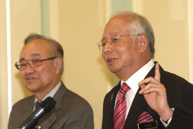 Minister in the Prime Minister's Department Datuk Paul Low and Prime Minister Datuk Seri Najib Tun Razak during a press conference