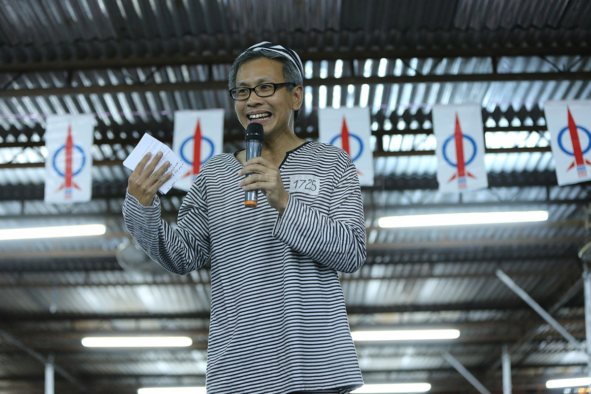 DAP's Tony Pua speaking at the DAP Fund Raising Dinner in Petaling Jaya last month, wearing prison clothes as a sign of protest.