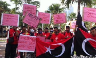 Protesters from Johor carrying racially charged posters.