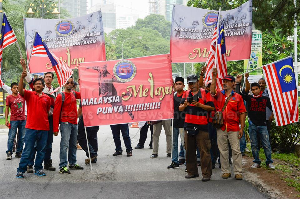 """Some of the protesters from the 'red shirt' rally yesterday holding posters that read: """"Malaysia Melayu Punya"""" (Malaysia Belongs To The Malays)"""