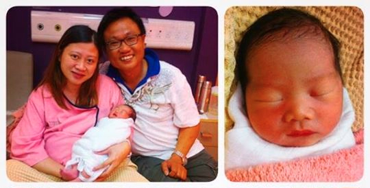 Happy parents, Mr and Mrs Kee with their newborn baby.