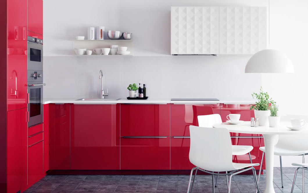 Feature a dose of bright colour to spice up a white-washed kitchen.