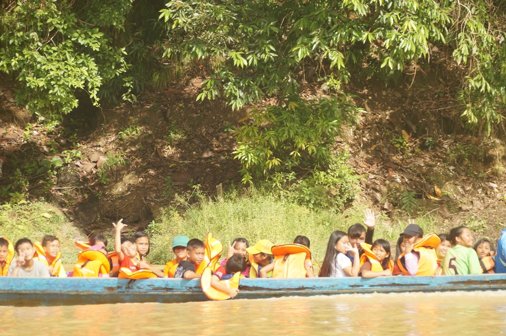 Students on the way to district sports day event by boat