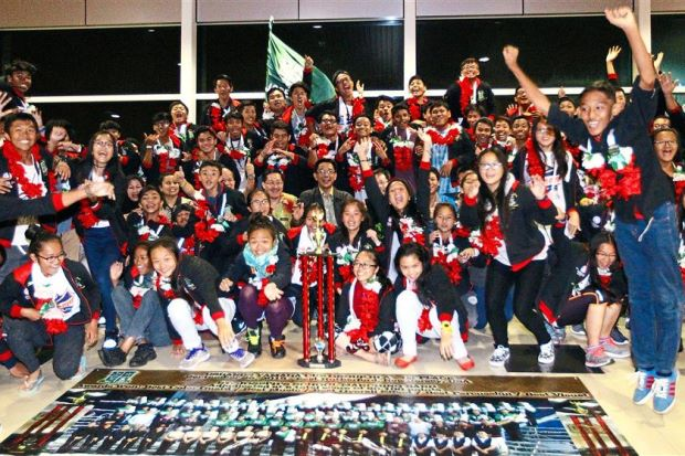 St Joseph's School Band members receiving a triumphant welcome at Kuching International Airport after their return from the US.