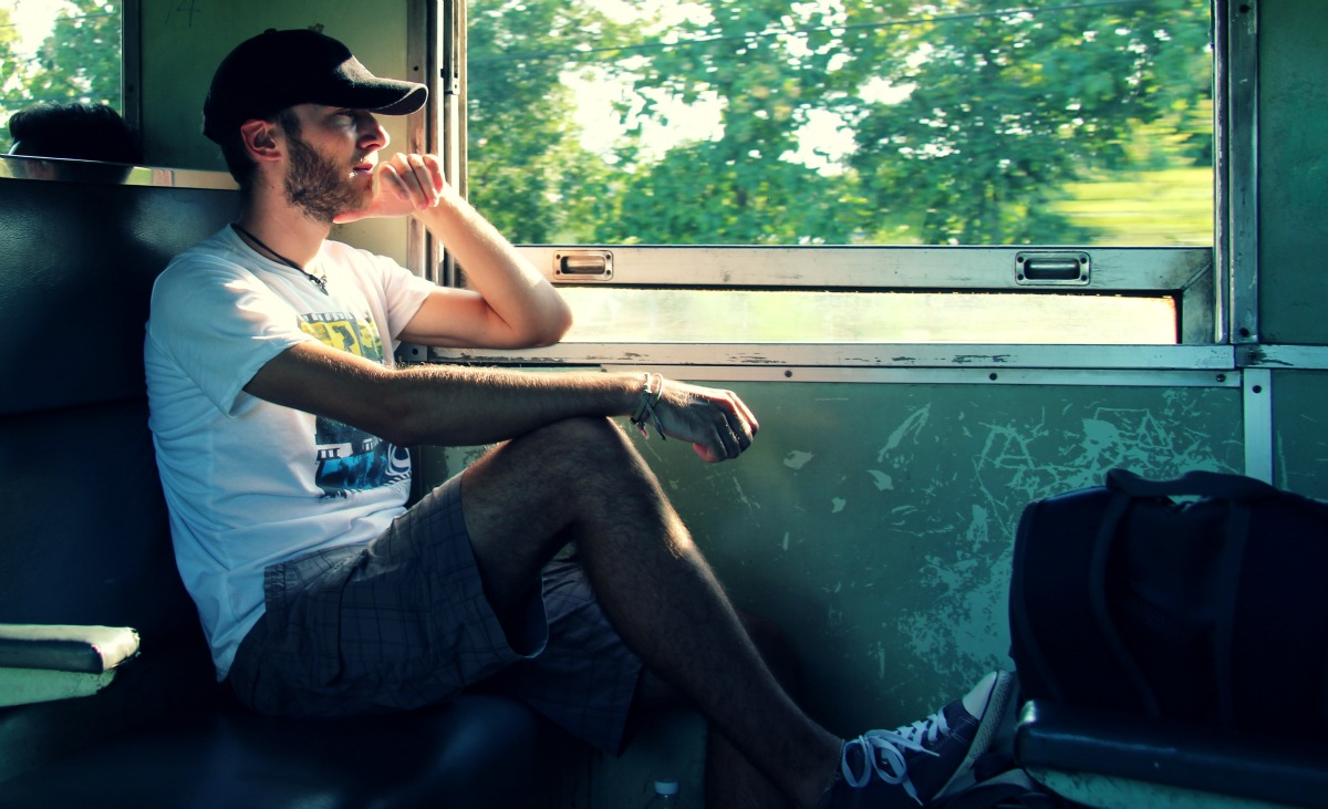 Christian, my boyfriend, pondering about his life, in a train from Bangkok to Kanchanaburi, Thailand