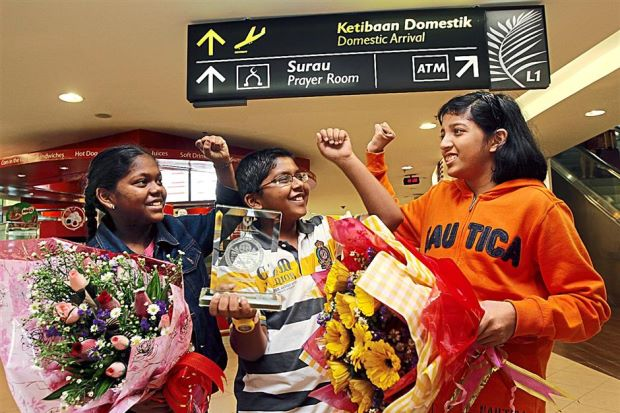 From left: Prevena, Rasyikash and Sushmeetha celebrating their winning the Double Gold Award at BIS 2014 during their arrival at KLIA.