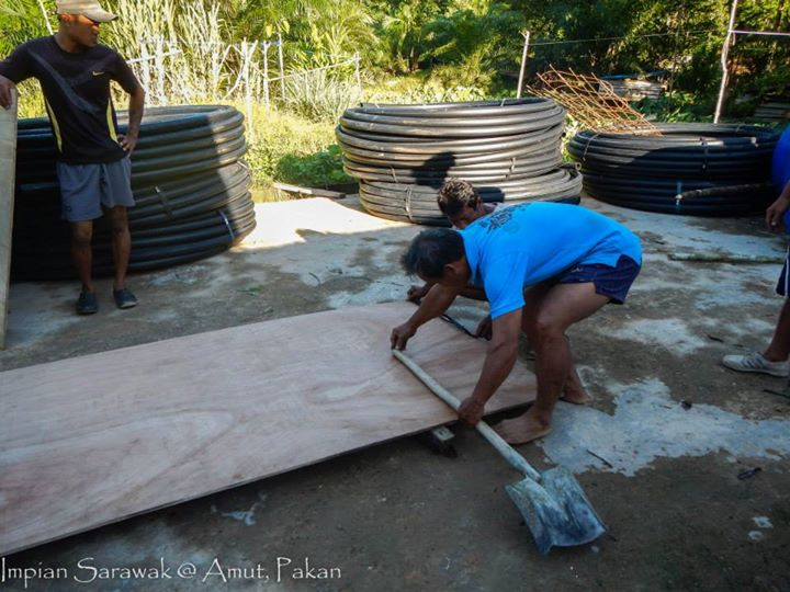 Villagers helping out the volunteers to build the gravity fed water system