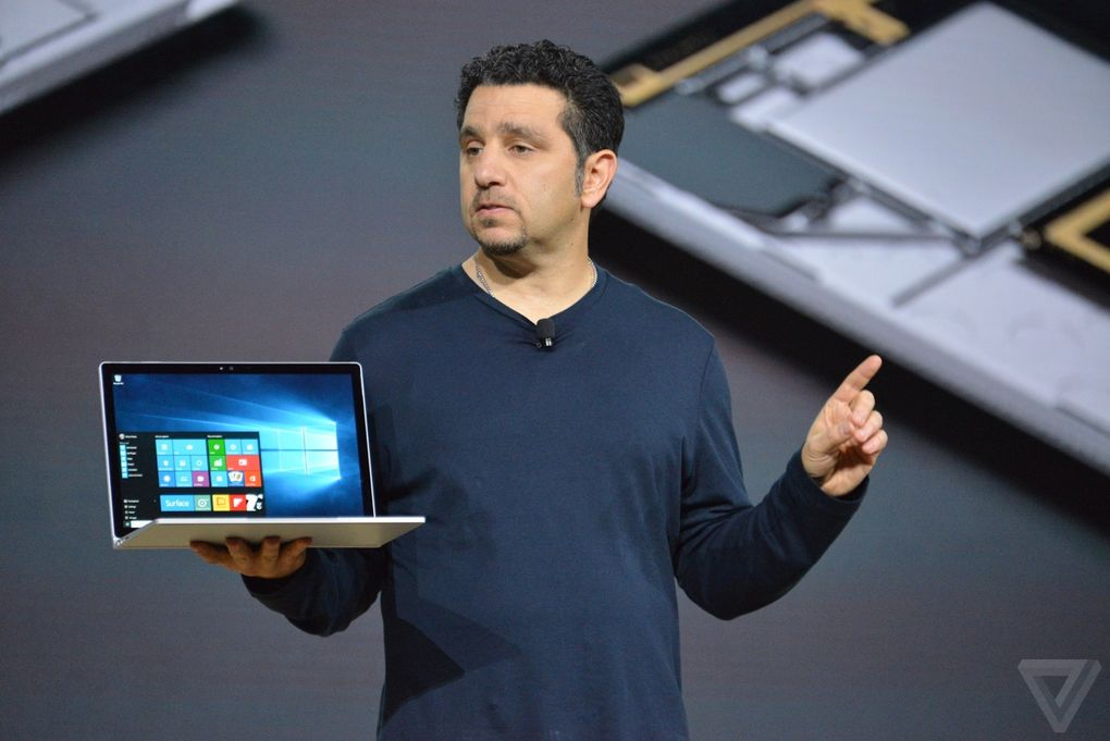 Microsoft's Surface head, Panos Panay holding the Surface Book.