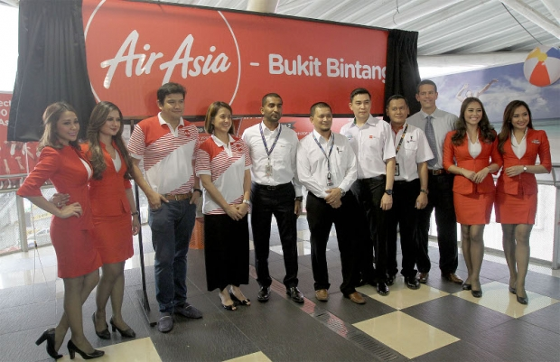 AirAsia staff members posing for a photograph during the launch of the AirAsia Bukit Bintang Monorail station.