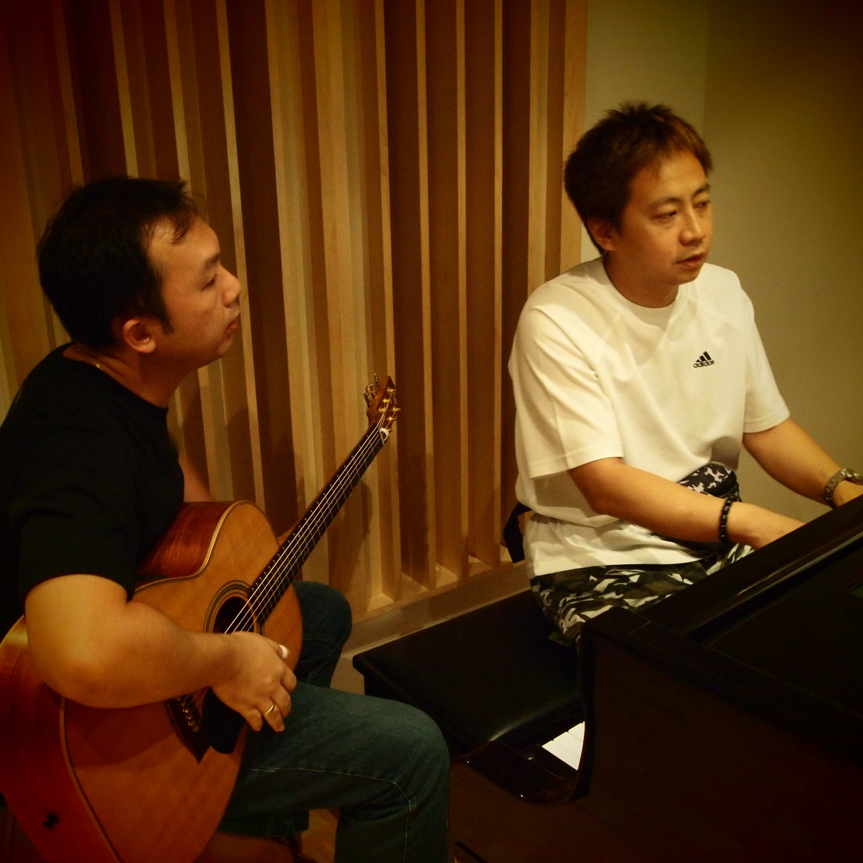 Roger Wang (left) and producer Andrew Tuason (right).