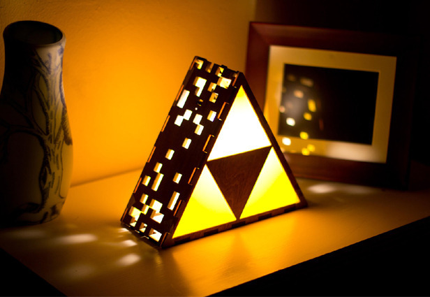 Video game-themed merch works just as well, like this 'Zelda'-inspired Triforce lamp.