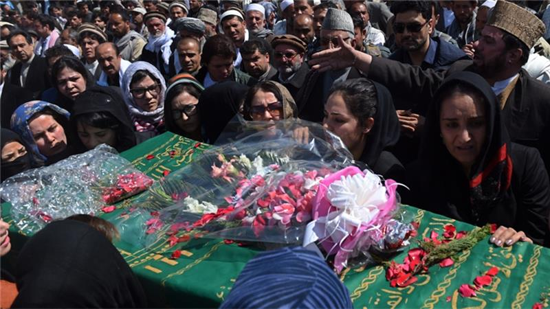 Afghan activist women carry the coffin of Farkhunda, who was lynched by an angry mob in central Kabul.