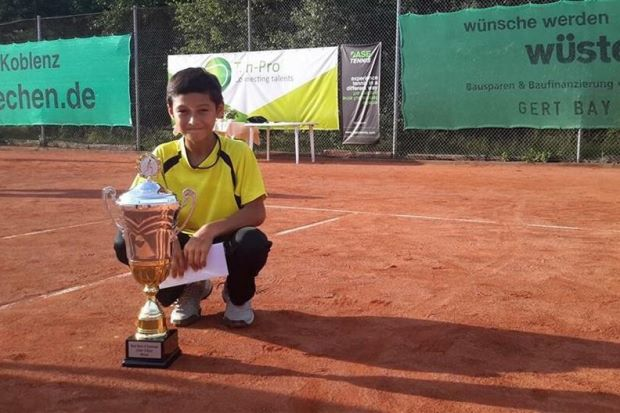 Imran posing with the trophy after winning the Base 11 and under Stars of Tomorrow tournament in Germany on August, 2015.