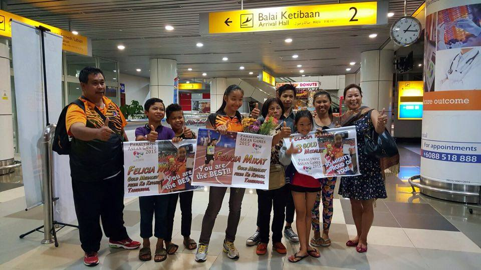 Felicia's extended family is seen welcoming her and her coach Mr. Tony Sawan.