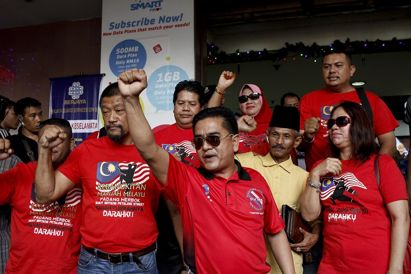 Gerakan Merah, led by Ali Tinju during the protest at the Kota Raya shopping mall