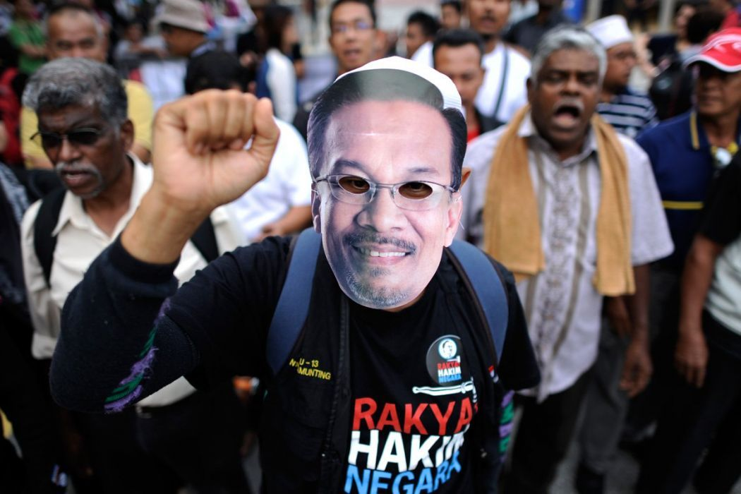 Protesters at pro-Anwar rally after he was imprisoned last February under sodomy charges