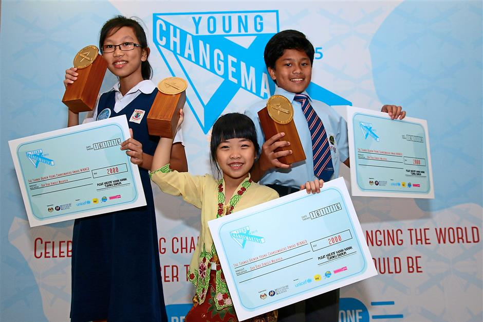Making a difference: the three Young Changemakers with their cheques.