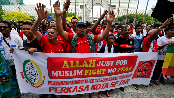 File photo of Muslim protestors displaying a banner during a demonstration against a Malaysian Catholic newspaper using the word 'Allah' at the Court of Appeal in Putrajaya in 2014.