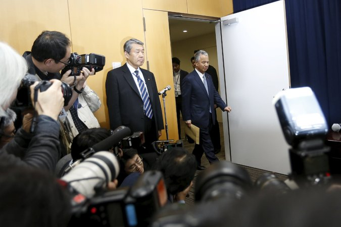 Akira Amari, right, Japan's economy minister, at a news conference on Thursday.