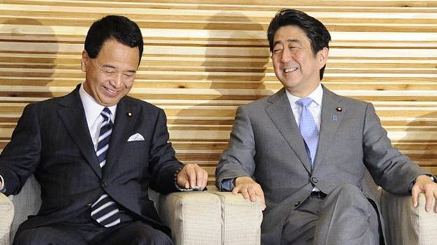 Mr Amari, left, has been described as one of Prime Minister Shinzo Abe's most trusted members of parliament.