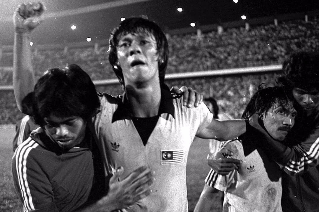James Wong celebrates after qualifying for the 1980 Olympics.