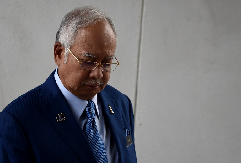 An embattled Najib Razak is accused by the opposition of trying to silence his critics.