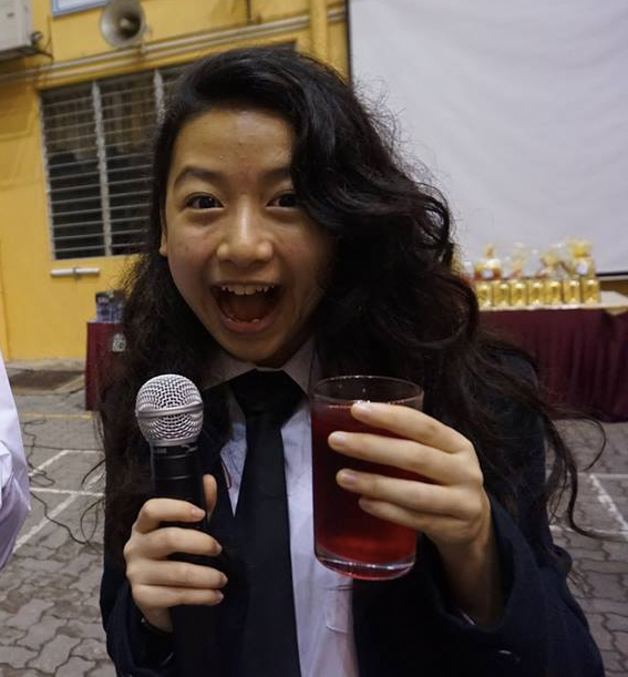 Ting Yi at her school's prefect farewell party.
