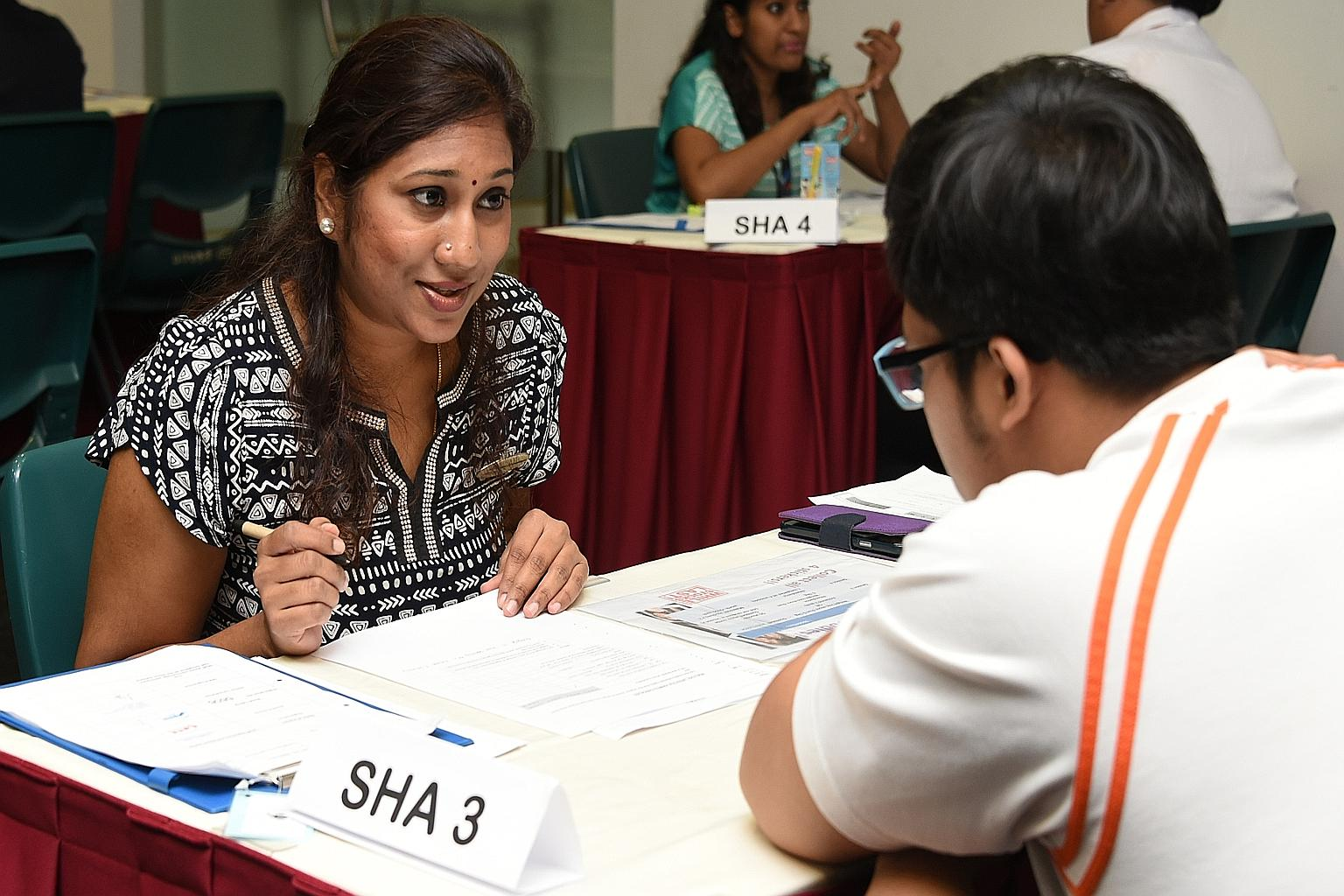 Student health adviser Mageswari D.N. Amaderlingam, 40, offering health advice to a student at ITE College Central.