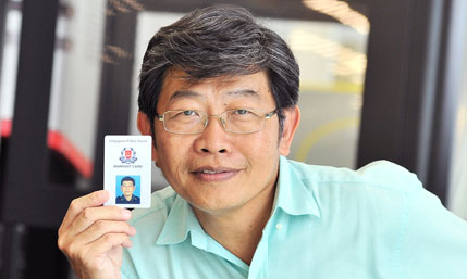 Robin Chia, an honorary Volunteer Special Constabulary (VSC) officer posing with his identification card.