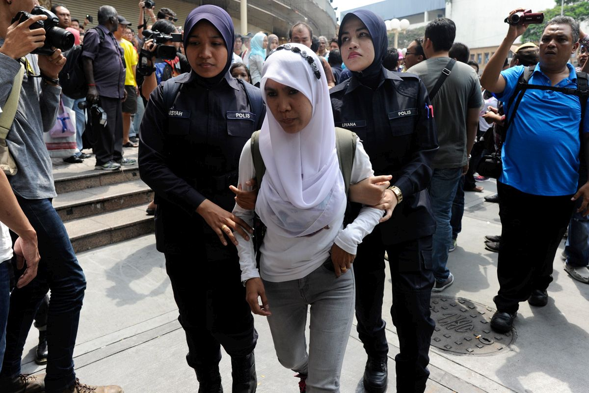 A young woman is arrested for being part of the #TangkapNajib rally outside the Sogo Department Store in Jalan Tuanku Abdul Rahman in KL on 1 August 2015.