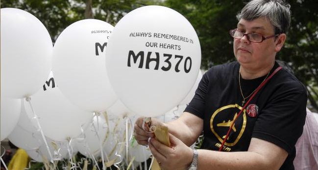Widow Jacquita Gomes prepares balloons with names of those who died, including her husband Patrick Gomes.
