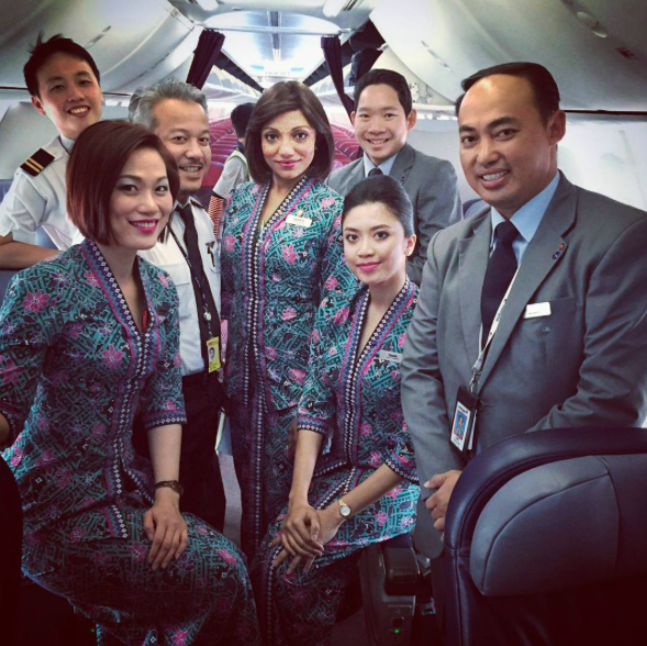 Suganthi (center) has been a cabin crew for 24 years.