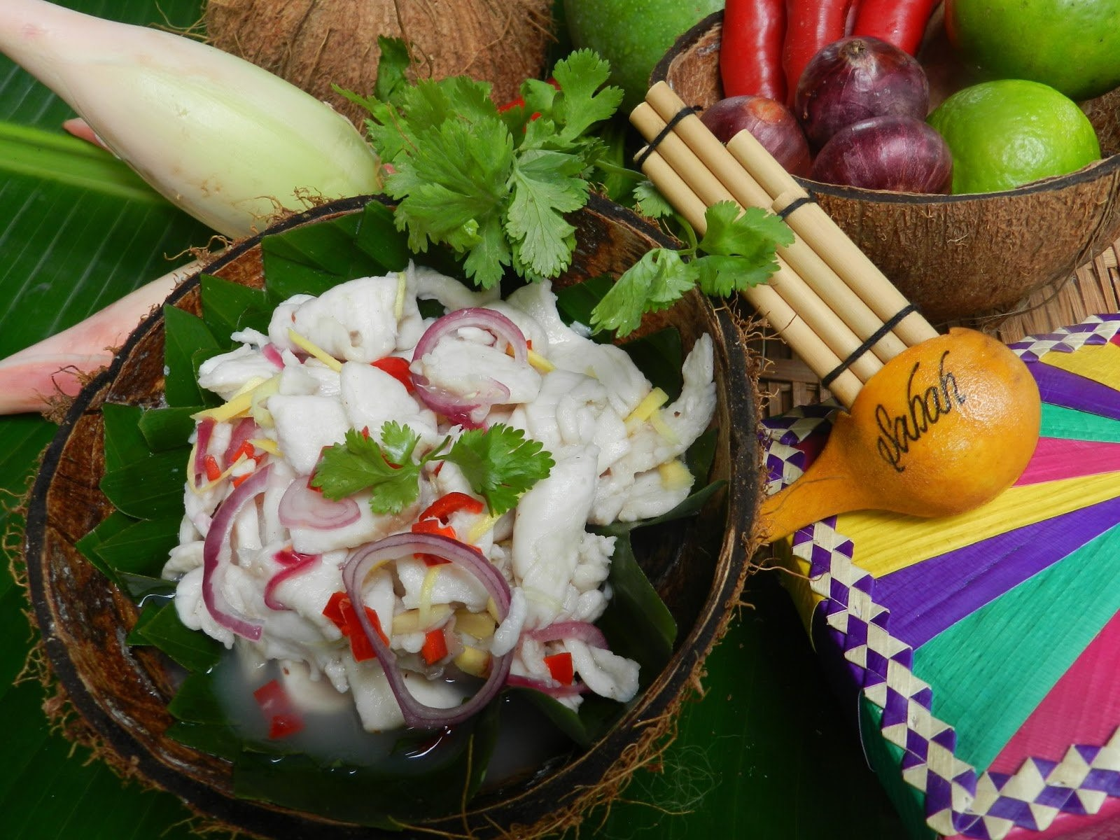 'Hinava', a famous Kadazan-Dusun salad that is prepared with fresh raw mackerel fish, onions, shavings of ginger and chili with a splash of lime juice