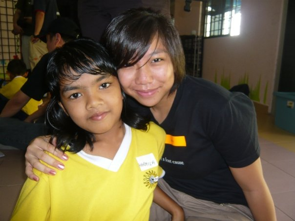 Sarah with a girl that she visited at the Budriah Outreach home as a volunteer with the Children at Risk programme back in 2007.