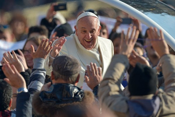 Pope Francis greets the crowd as he arrives for his general audience at St Peter's square on Wednesday, Dec 11, 2013 at the Vatican.